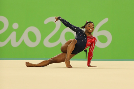 simone: RIO DE JANEIRO, BRAZIL - AUGUST 7, 2016: Olympic champion Simone Biles of United States competes on the floor exercise during womens all-around gymnastics qualification at Rio 2016 Olympic Games
