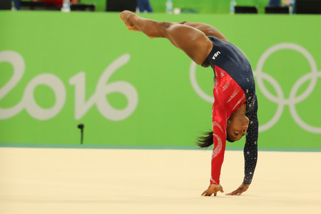 janeiro: RIO DE JANEIRO, BRAZIL - AUGUST 7, 2016: Olympic champion Simone Biles of United States competes on the floor exercise during womens all-around gymnastics qualification at Rio 2016 Olympic Games