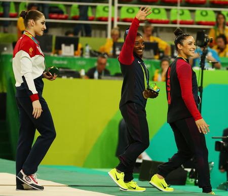 simone: RIO DE JANEIRO, BRAZIL -AUGUST 11, 2016:Womens all-around gymnastics medalists at Rio 2016 Olympic Games Aliya Mustafina of Russia (L),Simone Biles of USA and Aly Raisman of USA during medal ceremony Editorial
