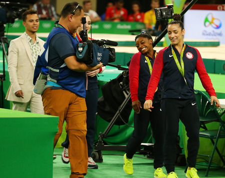 RIO DE JANEIRO, BRAZIL -AUGUST 11, 2016: Womens all-around gymnastics medalists at Rio 2016 Olympic Games Simone Biles of USA (L) and Aly Raisman of USA after medal ceremony at Rio Olympic Arena Editorial