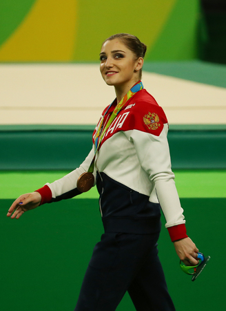 olympic symbol: RIO DE JANEIRO, BRAZIL -AUGUST 11, 2016: Womens all-around gymnastics bronze medalist at Rio 2016 Olympic Games Aliya Mustafina of Russian Federation after medal ceremony