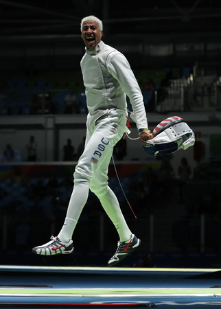 olympic symbol: RIO DE JANEIRO, BRAZIL - AUGUST 12, 2016: Fencer Miles Chamley-Watson of United States competes in the Mens team foil of the Rio 2016 Olympic Games at the Carioca Arena 3