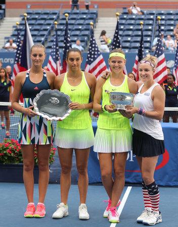 NEW YORK - SEPTEMBER 11, 2016: Kristina Mladenovic (L) , Caroline Garcia, (France), Lucie Safarova (Czech) and B. Mattek-Sands of USA during trophy presentation after US Open 2016 women doubles final