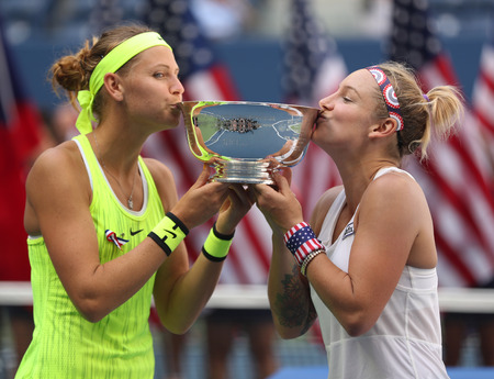 NEW YORK - SEPTEMBER 11, 2016: US Open 2016 women doubles champions Lucie Safarova (L) of Czech Republic and Bethanie Mattek-Sands of United States during trophy presentation in New York