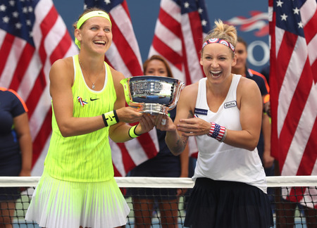 doubles: NEW YORK - SEPTEMBER 11, 2016: US Open 2016 women doubles champions Lucie Safarova (L) of Czech Republic and Bethanie Mattek-Sands of United States during trophy presentation in New York