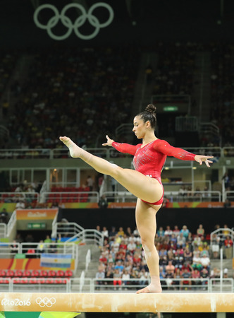 olympic ring: RIO DE JANEIRO, BRAZIL - AUGUST 11, 2016: Olympic champion Aly Raisman of United States competes on the balance beam at womens all-around gymnastics at Rio 2016 Olympic Games
