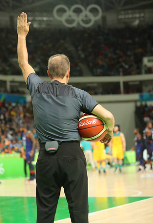 RIO DE JANEIRO, BRAZIL - AUGUST 10, 2016: Basketball referee in action at group A basketball match between Team USA and Australia of the Rio 2016 Olympic Games