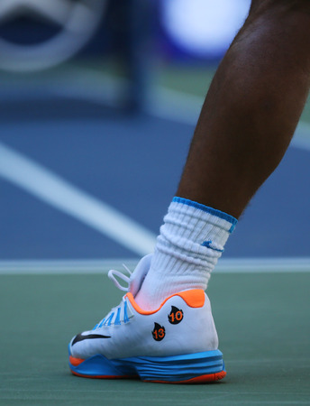 champion spain: NEW YORK - AUGUST 29, 2016: Grand Slam champion Rafael Nadal of Spain wears custom Nike tennis shoes during US Open 2016 first round match at Billie Jean King National Tennis Center