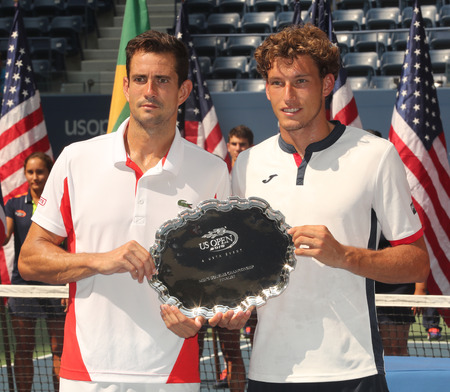 doubles: NEW YORK - SEPTEMBER 10, 2016: US Open 2016 men doubles runners up Guillermo Garcia-Lopez (L) and Pablo Carreno Busta of Spain during trophy presentation at the Billie Jean King National Tennis Center Editorial