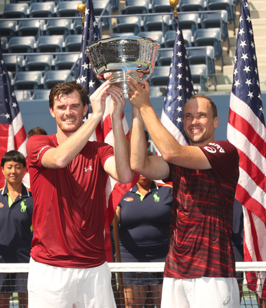 doubles: NEW YORK - SEPTEMBER 10, 2016: US Open 2016 men doubles champions Jamie Murray (L) of Great Britain and Bruno Soares of Brazil during trophy presentation at the Billie Jean King National Tennis Center Editorial