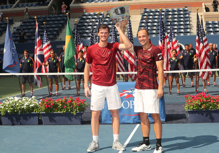 billie: NEW YORK - SEPTEMBER 10, 2016: US Open 2016 men doubles champions Jamie Murray (L) of Great Britain and Bruno Soares of Brazil during trophy presentation at the Billie Jean King National Tennis Center Editorial