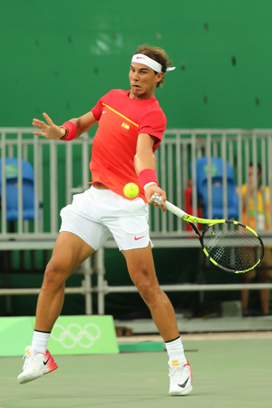 champion spain: RIO DE JANEIRO, BRAZIL - AUGUST 12, 2016: Olympic champion Rafael Nadal of Spain in action during mens singles first round match of the Rio 2016 Olympic Games at the Olympic Tennis Centre