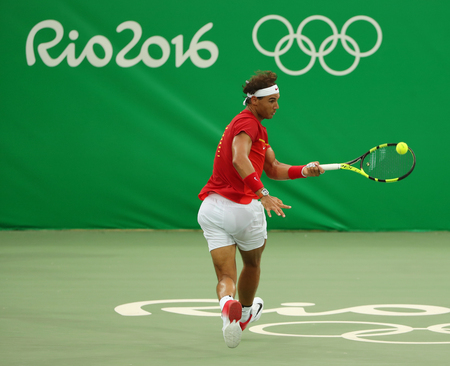 atp: RIO DE JANEIRO, BRAZIL - AUGUST 12, 2016: Olympic champion Rafael Nadal of Spain in action during mens singles first round match of the Rio 2016 Olympic Games at the Olympic Tennis Centre