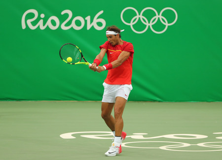 spaniard: RIO DE JANEIRO, BRAZIL - AUGUST 12, 2016: Olympic champion Rafael Nadal of Spain in action during mens singles first round match of the Rio 2016 Olympic Games at the Olympic Tennis Centre
