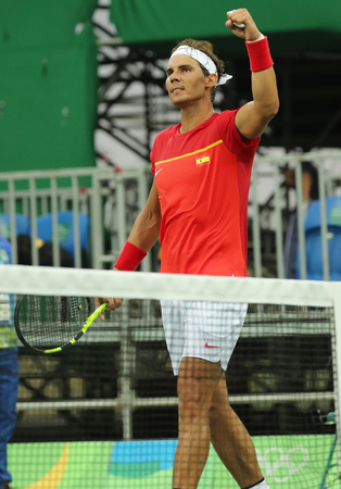champion spain: RIO DE JANEIRO, BRAZIL - AUGUST 12, 2016: Olympic champion Rafael Nadal of Spain celebrates victory after mens singles first round match of the Rio 2016 Olympic Games at the Olympic Tennis Centre
