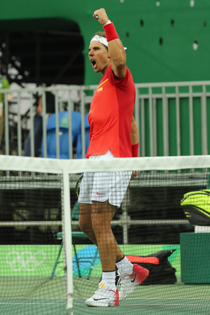RIO DE JANEIRO, BRAZIL - AUGUST 12, 2016: Olympic champion Rafael Nadal of Spain celebrates victory after mens singles first round match of the Rio 2016 Olympic Games at the Olympic Tennis Centre