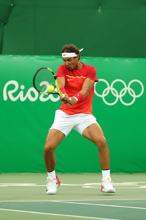 RIO DE JANEIRO, BRAZIL - AUGUST 12, 2016: Olympic champion Rafael Nadal of Spain in action during mens singles first round match of the Rio 2016 Olympic Games at the Olympic Tennis Centre