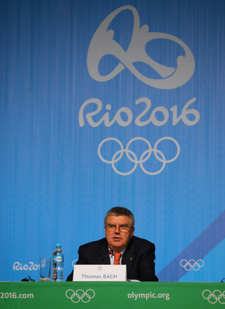 olympic ring: RIO DE JANEIRO, BRAZIL - AUGUST 7, 2016: President of the International Olympic Committee Thomas Bach during press conference at Rio 2016 Olympic Games Press Center Editorial