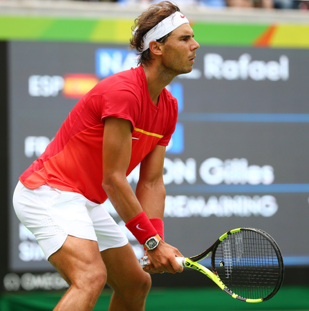 olympic ring: RIO DE JANEIRO, BRAZIL - AUGUST 11, 2016: Olympic champion Rafael Nadal of Spain in action during mens singles round four of the Rio 2016 Olympic Games at the Olympic Tennis Centre