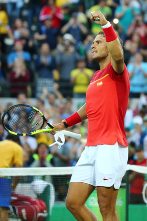 champion spain: RIO DE JANEIRO, BRAZIL - AUGUST 12, 2016: Olympic champion Rafael Nadal of Spain celebrates victory after mens singles quarterfinal of the Rio 2016 Olympic Games at the Olympic Tennis Centre