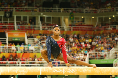 the olympic rings: RIO DE JANEIRO, BRAZIL AUGUST 7, 2016: Olympic champion Simone Biles of United States competing on the balance beam at womens all-around gymnastics qualification at Rio 2016 Olympic Games