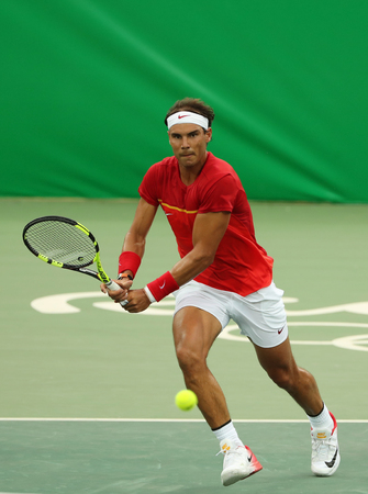 spaniard: RIO DE JANEIRO, BRAZIL - AUGUST 7, 2016: Olympic champion Rafael Nadal of Spain in action during mens singles first round match of the Rio 2016 Olympic Games at the Olympic Tennis Centre