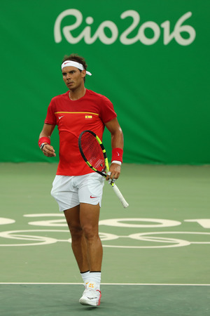 champion spain: RIO DE JANEIRO, BRAZIL - AUGUST 7, 2016: Olympic champion Rafael Nadal of Spain in action during mens singles first round match of the Rio 2016 Olympic Games at the Olympic Tennis Centre