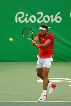 the olympic rings: RIO DE JANEIRO, BRAZIL - AUGUST 7, 2016: Olympic champion Rafael Nadal of Spain in action during mens singles first round match of the Rio 2016 Olympic Games at the Olympic Tennis Centre