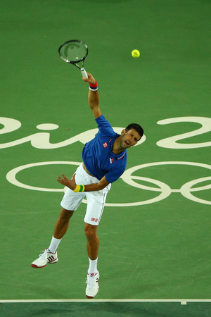 the olympic rings: RIO DE JANEIRO, BRAZIL - AUGUST 7, 2016: Grand Slam champion Novak Djokovic of Serbia in action during mens singles first round match of the Rio 2016 Olympic Games at the Olympic Tennis Centre Editorial