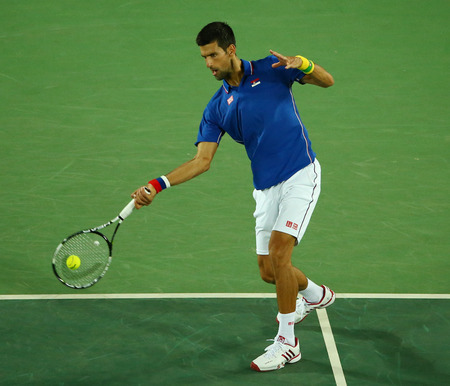 RIO DE JANEIRO, BRAZIL - AUGUST 7, 2016: Grand Slam champion Novak Djokovic of Serbia in action during mens singles first round match of the Rio 2016 Olympic Games at the Olympic Tennis Centre Editorial