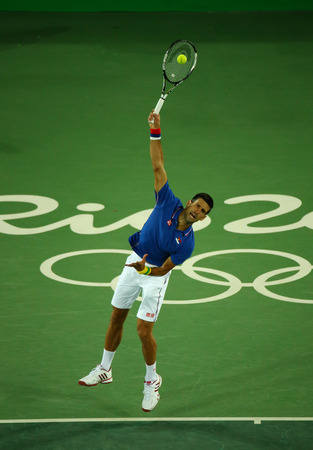 olympic ring: RIO DE JANEIRO, BRAZIL - AUGUST 7, 2016: Grand Slam champion Novak Djokovic of Serbia in action during mens singles first round match of the Rio 2016 Olympic Games at the Olympic Tennis Centre Editorial
