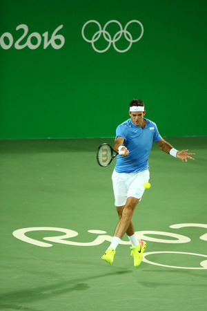 RIO DE JANEIRO, BRAZIL - AUGUST 5, 2016: Grand Slam Champion Juan Martin Del Porto of Argentina in action during mens singles first round match of the Rio 2016 Olympics at the Olympic Tennis Centre