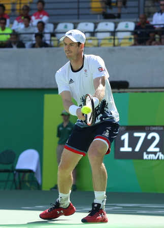 RIO DE JANEIRO, BRAZIL - AUGUST 13, 2016: Olympic champion Andy Murray of Great Britain in action during mens singles semifinal of the Rio 2016 Olympic Games at the Olympic Tennis Centre
