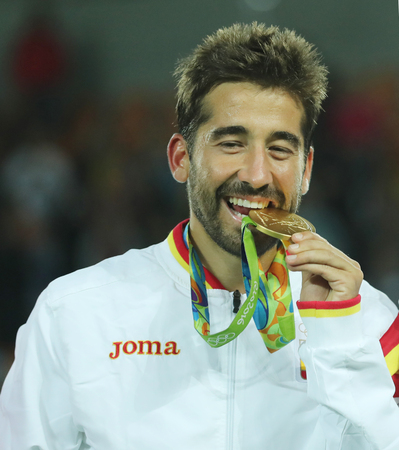 champion spain: RIO DE JANEIRO, BRAZIL - AUGUST 12, 2016: Olympic champion Mark Lopez of Spain during medal ceremony after victory at mens doubles final of the Rio 2016 Olympic Games