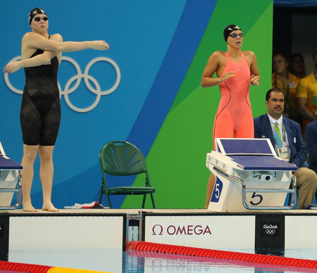 the olympic rings: RIO DE JANEIRO, BRAZIL - AUGUST 8, 2016: Lilly King of United States (L) and Yulia Efimova of Russia before Womens 100m Breaststroke Final of the Rio 2016 Olympic Games at Olympic Aquatics Stadium Editorial