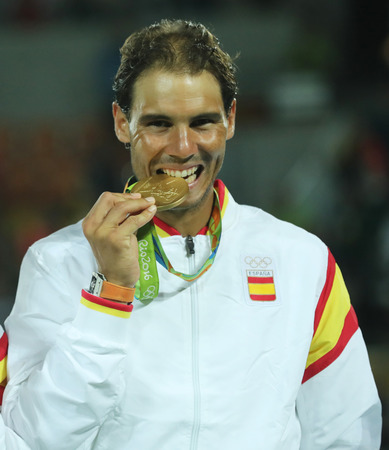 champion spain: RIO DE JANEIRO, BRAZIL - AUGUST 12, 2016: Olympic champion Rafael Nadal of Spain during medal ceremony after victory at mens doubles final of the Rio 2016 Olympic Games