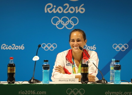 summer olympics: RIO DE JANEIRO, BRAZIL - AUGUST 13, 2016: Olympic champion Monica Puig of Puerto Rico during press conference after victory at tennis womens singles final of the Rio 2016 Olympic Games