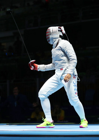 individuals: RIO DE JANEIRO, BRAZIL - AUGUST 13, 2016: Ibtihaj Muhammad of United States competes in the Womens Sabre Team of the Rio 2016 Olympic Games at Carioca Arena 3 Editorial