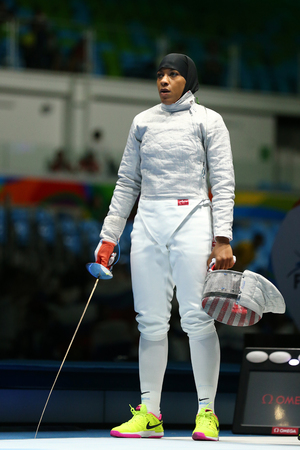 RIO DE JANEIRO, BRAZIL - AUGUST 8, 2016: Ibtihaj Muhammad of the United States in action during Womens individual sabre match of the Rio 2016 Olympic Games at the Carioca Arena 3