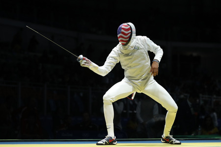 RIO DE JANEIRO, BRAZIL - AUGUST 12, 2016: Fencer Miles Chamley-Watson of United States competes in the Mens team foil of the Rio 2016 Olympic Games at the Carioca Arena 3