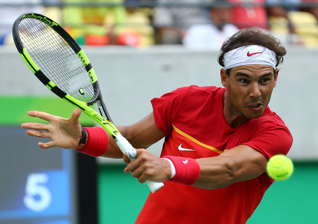 RIO DE JANEIRO, BRAZIL - AUGUST 11, 2016: Olympic champion Rafael Nadal of Spain in action during mens singles round four of the Rio 2016 Olympic Games at the Olympic Tennis Centre