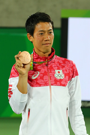 RIO DE JANEIRO, BRAZIL - AUGUST 14, 2016: Bronze medalist Kei Nishikori of Japan during tennis mens singles medal ceremony of the Rio 2016 Olympic Games at the Olympic Tennis Centre