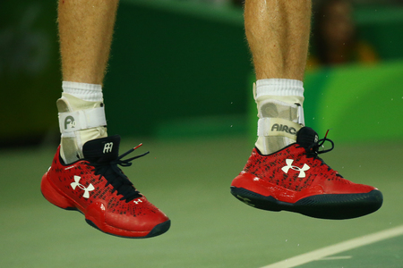 RIO DE JANEIRO, BRAZIL - AUGUST 14, 2016: Olympic champion Andy Murray of Great Britain wears custom Under Armour tennis shoes during mens singles final of the Rio 2016 Olympic Games