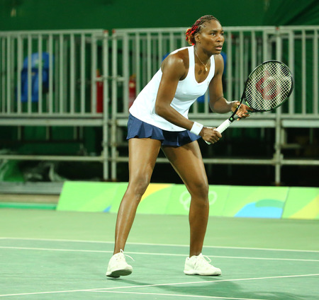 janeiro: RIO DE JANEIRO, BRAZIL - AUGUST 7, 2016: Olympic champion Venus Williams of United States in action during doubles first round match of the Rio 2016 Olympic Games at the Olympic Tennis Centre