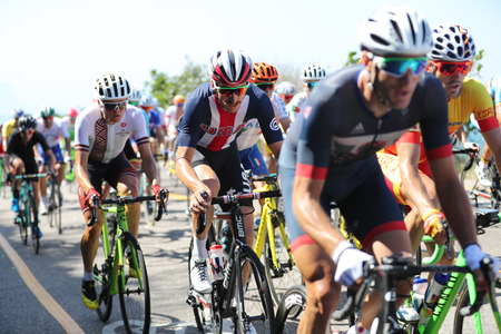 brent: RIO DE JANEIRO, BRAZIL - AUGUST 6, 2016: Cyclist Brent Bookwalter of Team USA (center) rides during Rio 2016 Olympic Cycling Road competition of the Rio 2016 Olympic Games in Rio de Janeiro