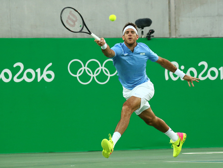 world championships: RIO DE JANEIRO, BRAZIL - AUGUST 14, 2016: Grand Slam champion Juan Martin Del Potro of Argentina in action during his men singles final match of the Rio 2016 Olympic Games at the Olympic Tennis Centre