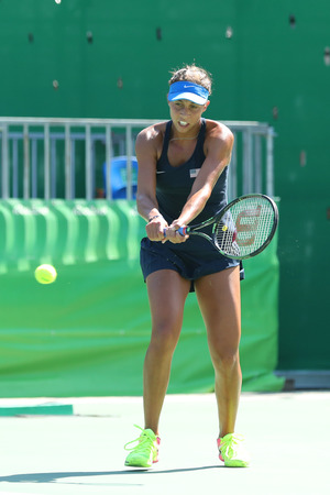 RIO DE JANEIRO, BRAZIL - AUGUST 13, 2016: Professional tennis player Madison Keys of United States in action during her semifinal match of the Rio 2016 Olympic Games at the Olympic Tennis Centre
