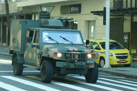 law of brazil: RIO DE JANEIRO, BRAZIL - AUGUST 6, 2016: Brazilian army forces provide security during Rio 2016 Olympic Games near Olympic Park in Rio de Janeiro
