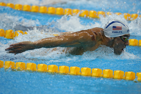 RIO DE JANEIRO, BRAZIL - AUGUST 8, 2016: Olympic champion Michael Phelps of United States swims the Mens 200m butterfly Heat 3 of Rio 2016 Olympic Games at Olympic Aquatic Stadium Editorial