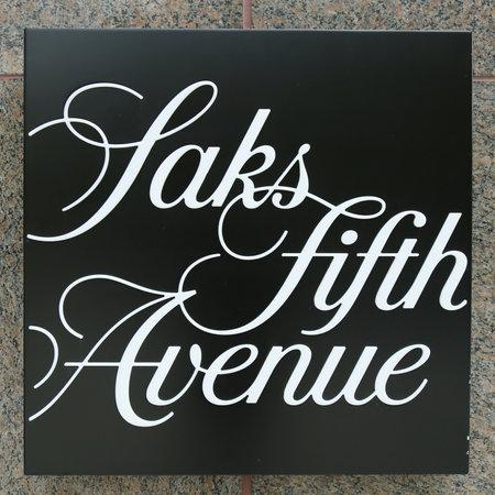 fifth avenue: NEW YORK - NOVEMBER 3, 2016: Saks Fifth Avenue store sign in Manhattan, New York.